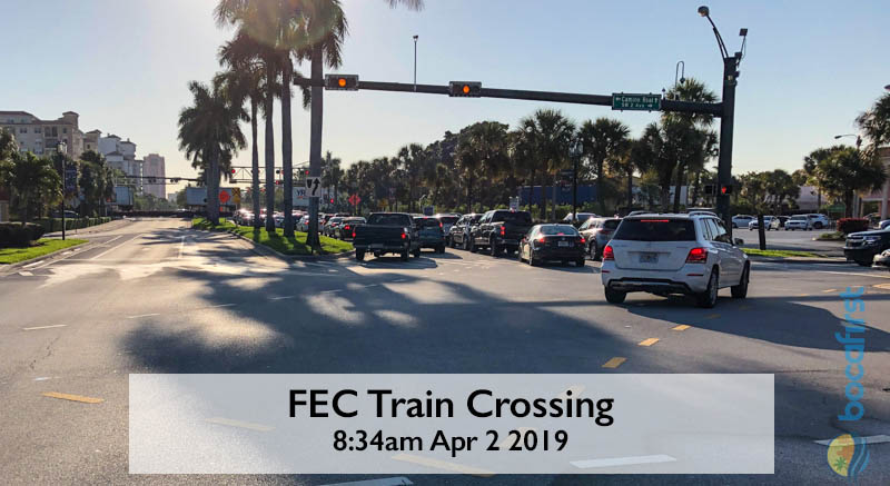 FEC Train Crossing at Morning Rush Hour