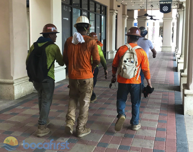 Downtown workers returning to their cars at Mizner Park